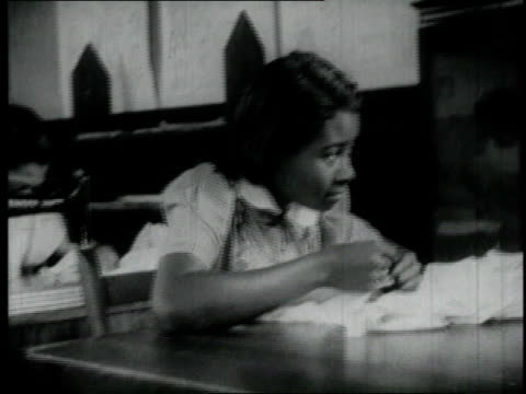 1940 montage teenagers sewing in a classroom / united states - sewing stock videos & royalty-free footage