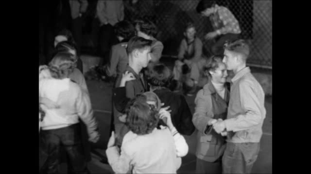 night teenagers slow dancing together inside fenced basketball court female teens standing by portable speaker young teens sitting in bleachers vs... - slow dancing stock videos and b-roll footage