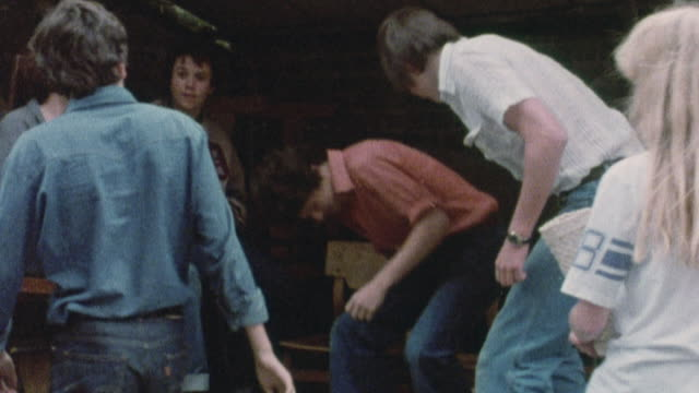 1978 montage teenagers socializing and smoking / united kingdom† - smoking stock-videos und b-roll-filmmaterial