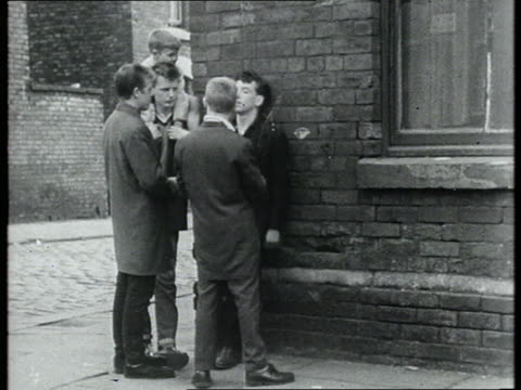 teenagers stand on street corner - gang stock videos and b-roll footage