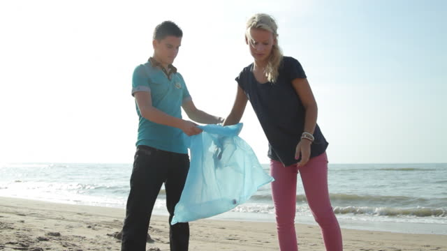 Teenagers Volunteering Beach Cleanup