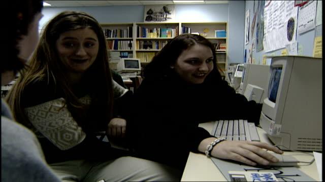 stockvideo's en b-roll-footage met teenagers working on computers in classroom in snohomish, washington - 1997