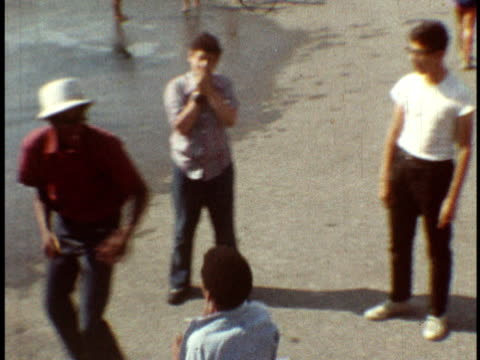 1973 MS Teens and kids sparring in playground / Bronx, New York