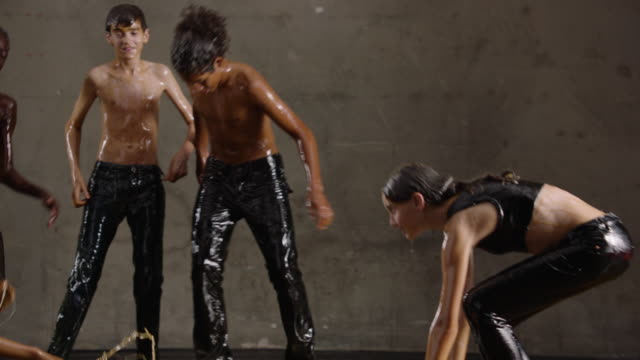 Teens dance in honey, slow motion
