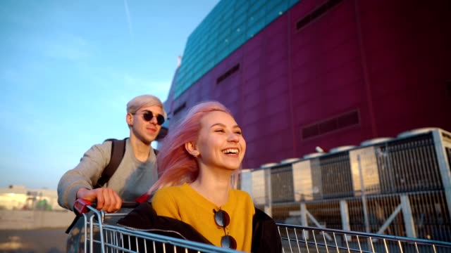 teens in exciting ride with shopping cart - pink hair stock videos & royalty-free footage