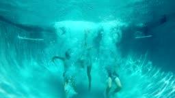 Teens Jump Into Pool