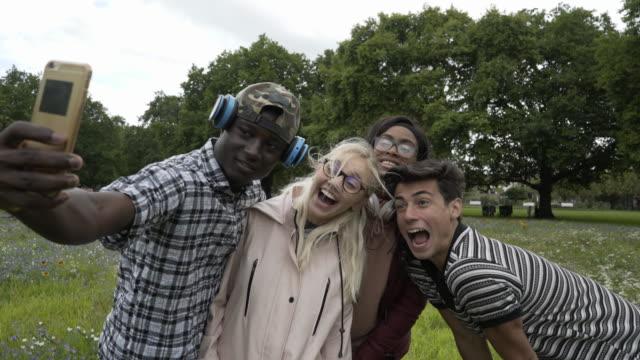 Teens making selfie pictures.