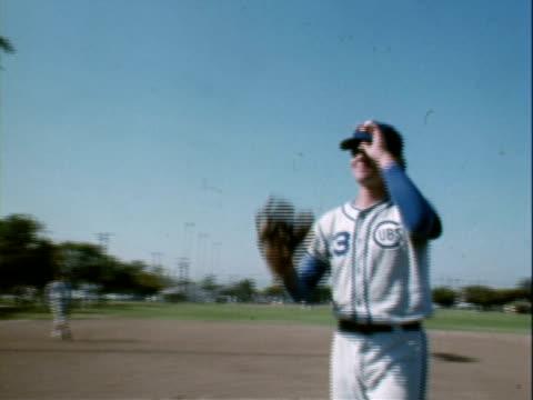Teens playing baseball