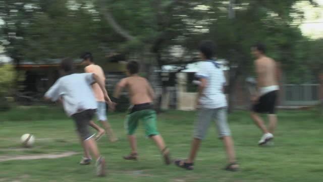 MS TS Teens playing soccer in field / Ituzaingo, Cordoba, Argentina