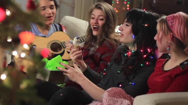 Teens sampling Christmas cupcake