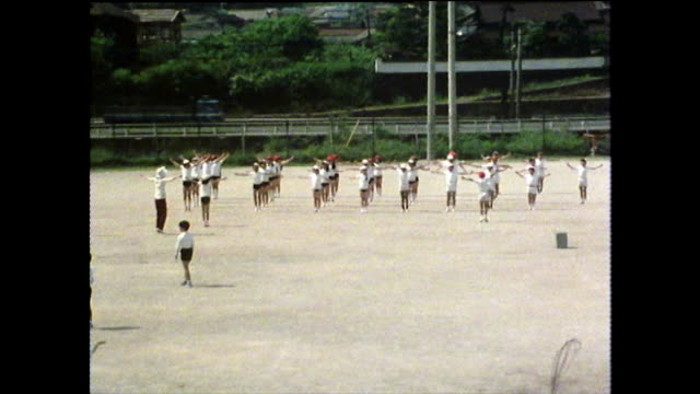 teens synchronised outdoor exercise in school; japan, 1975 - obedience stock videos & royalty-free footage