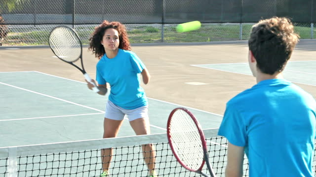teens taking tennis clinic, including handicapped girl - amputee stock videos & royalty-free footage