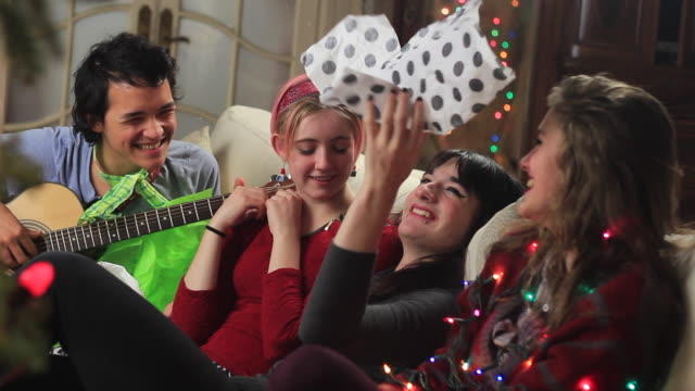 teens tossing christmas paper in the air - christmas wrapping paper stock videos & royalty-free footage