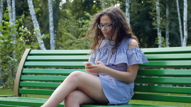 Teens Using Social Media. girl communicates in social networks on the smartphone