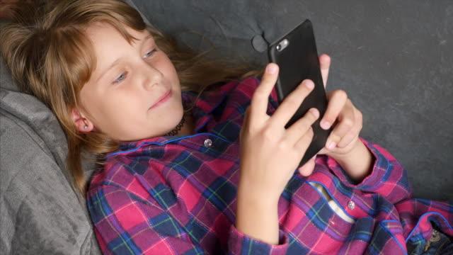 Teens Using Social Media. teen girl uses a smartphone