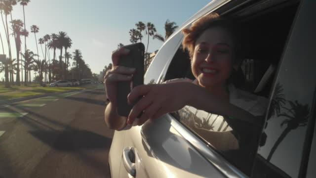 teens using social media - sedile del passeggero video stock e b–roll