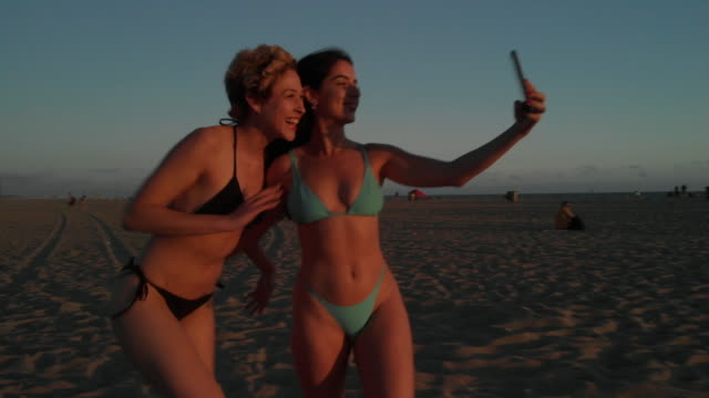 teens using social media - swimwear stock videos & royalty-free footage