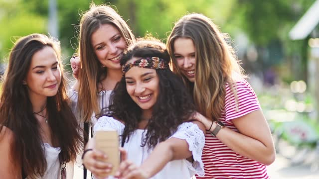 teens using the smartphone in the city - teenage girls stock videos & royalty-free footage