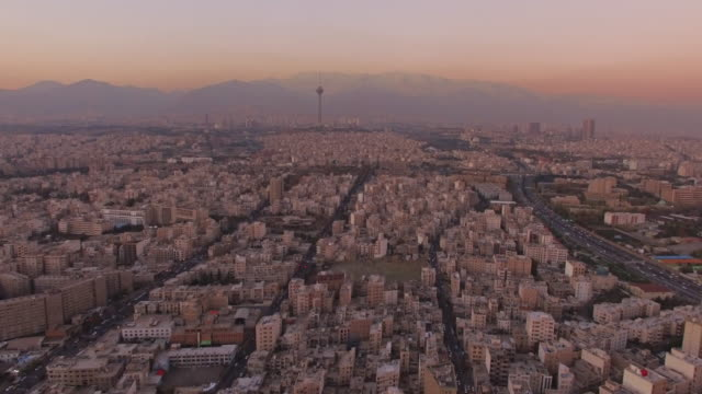 vídeos de stock e filmes b-roll de tehran aerial twilight city sunset - 2015