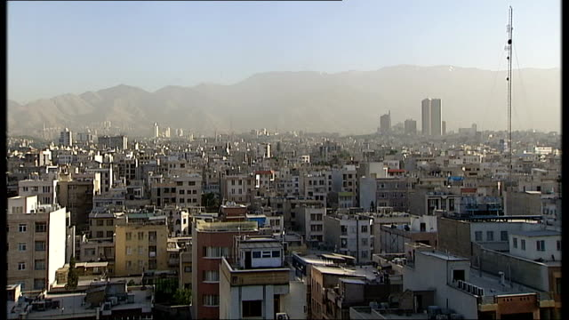tehran cityscapes / shia shrine at qom; iran: tehran: ext high angle view tehran cityscape rooftops and mountains / milad tower and cityscape / high... - shrine stock videos & royalty-free footage