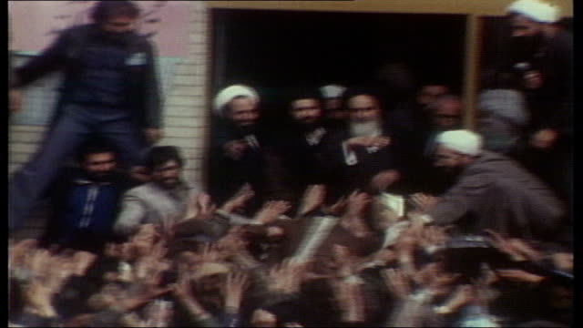 tehran ext massed crowds surrounding ayatollah ruhollah musavi khomeini end lib - 1979 stock videos & royalty-free footage