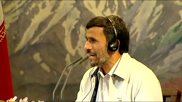 mahmoud ahmadinejad waving to gathered press and supporters at press conference general views of press conference - itn reporter seated at press... - barricade stock videos & royalty-free footage