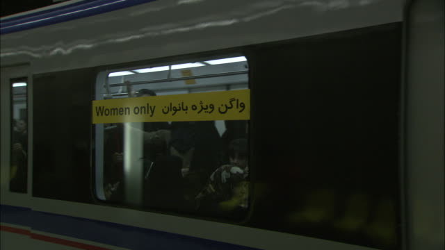 a tehran metro train departs a station. - iran stock-videos und b-roll-filmmaterial