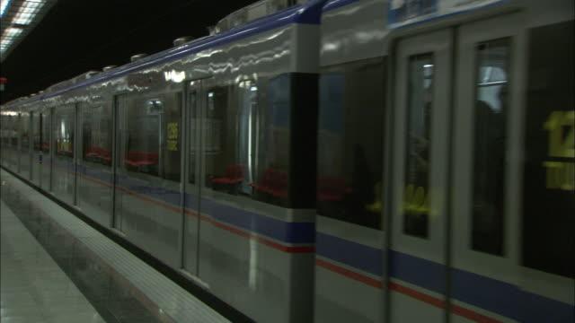a tehran metro train departs a station. - tehran stock videos & royalty-free footage