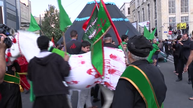 tehran skyline and day of ashura commmemoration; flammable liquid thrown onto outside of tent / horse wearing white sheet with red paint stains led... - flammable stock videos & royalty-free footage