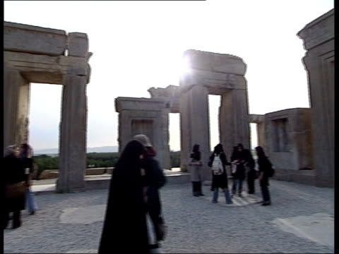 tehran to allow ancient artefacts to be exhibited in europe blue truck driving past ancient ruins of persepolis gv ancient limestone ruins of... - persepoli video stock e b–roll