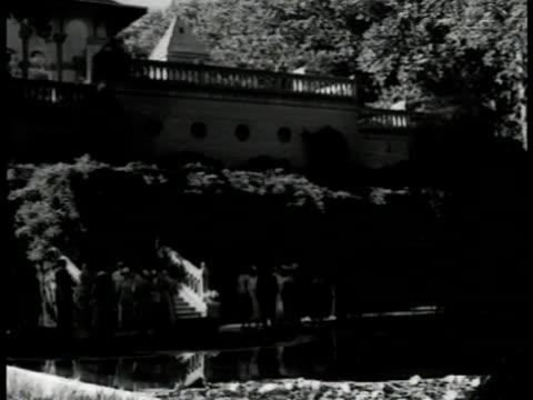 tehran vs people at british embassy garden party british ambassador wife shaking hands w/ russian ambassador ivan sadikov russian ambassador ivan... - 1951 stock videos & royalty-free footage