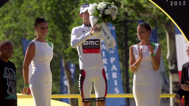 tejay van garderen on the podium on the champs elysees on stage 20 of 2012 tour de france - tour de france stock videos & royalty-free footage