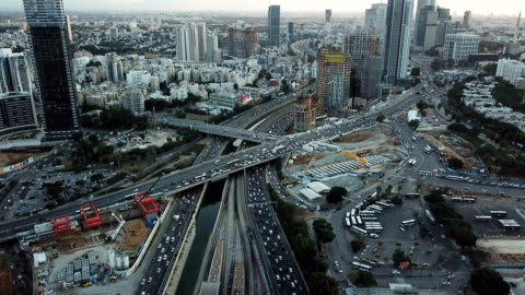 tel aviv aerial /busy traffic in ayalon highway, with towers and financial district - テルアビブ点の映像素材/bロール