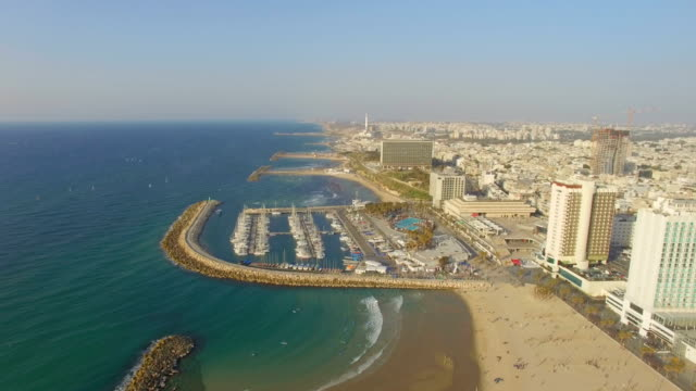tel aviv aerial/ mediterranean coastline with hotels, beaches and marina, israel - tel aviv stock-videos und b-roll-filmmaterial