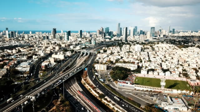 tel aviv aerial with towers and financial district/ busy traffic day in ayalon highway - tel aviv stock-videos und b-roll-filmmaterial