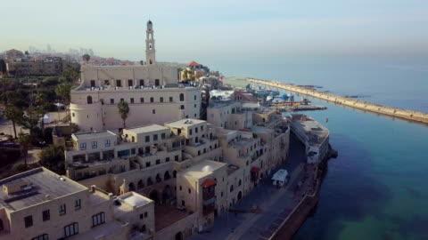 tel aviv - jaffa / aerial drone footage. fly from saint peter's church in jaffa to marina and boats, israel - テルアビブ点の映像素材/bロール