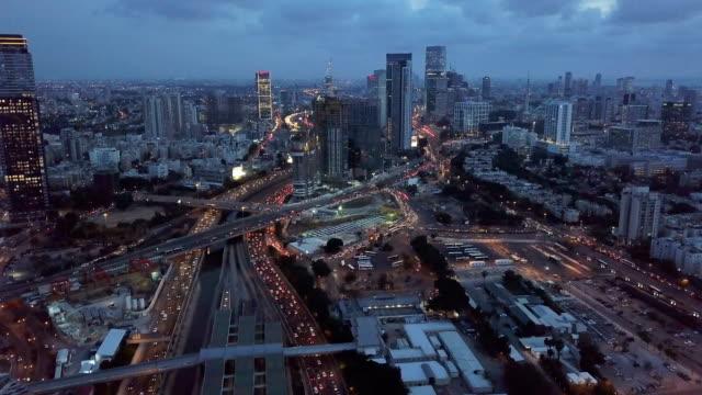 tel aviv skyline - aerial footage of tel aviv's center with ayalon freeway at sunset - major road stock-videos und b-roll-filmmaterial