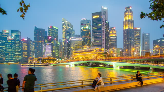 tele day to night timelapse of marina bay in singapore - river singapore stock videos & royalty-free footage