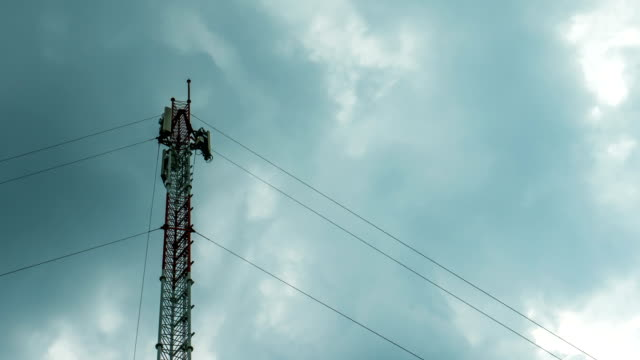 telecommunication tower and cloudy sky, time lapse - mast stock videos & royalty-free footage