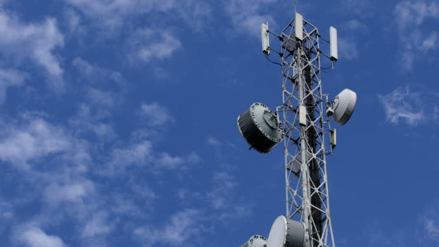telecommunication tower with cloud in the sky - microwave stock videos & royalty-free footage