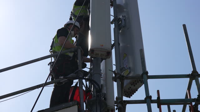 telecoms rigging team undertakes on-site work to replace huawei 4g with nokia 5g network systems at the muswell court site in hull, u.k., on tuesday,... - computer network stock videos & royalty-free footage
