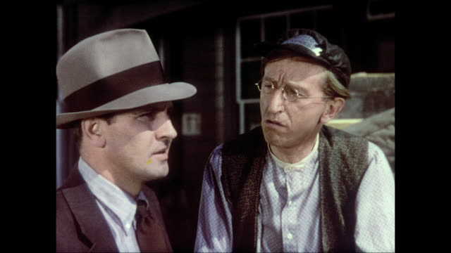 1937 telegraph office man tries to dissuade reporter (fredric march) from pursuing stories in his town - telegraf stock-videos und b-roll-filmmaterial
