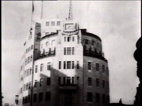 telegraph operator sends a message / a building with tall antenna on top / a control room with many dials on walls where message arrives - manövrera bildbanksvideor och videomaterial från bakom kulisserna