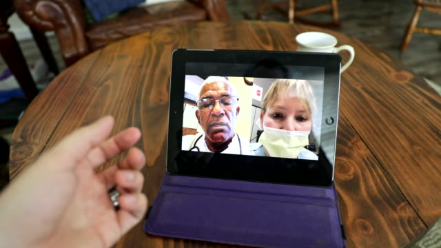 telemedicine on a digital tablet - civilian stock videos & royalty-free footage