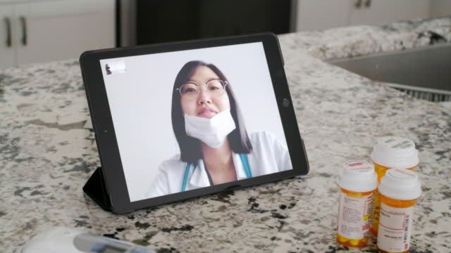 telemedicine virtual doctor visit - visit stock videos & royalty-free footage