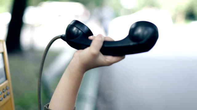 telephone handset in hands of child - public phone stock videos & royalty-free footage