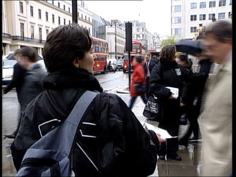 telephone numbers about to change itn london woman handing out leaflets and telling people sot the numbers change on saturday tcs leaflets held cbv... - directory stock videos and b-roll footage