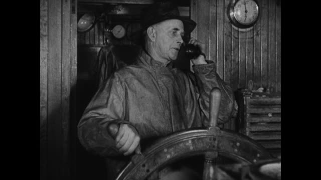 Telephone on steam trawler DRAMATIZATION Captain Atwood making telephone call SOT asking about market man at desk saying 'Looks like it will hold'