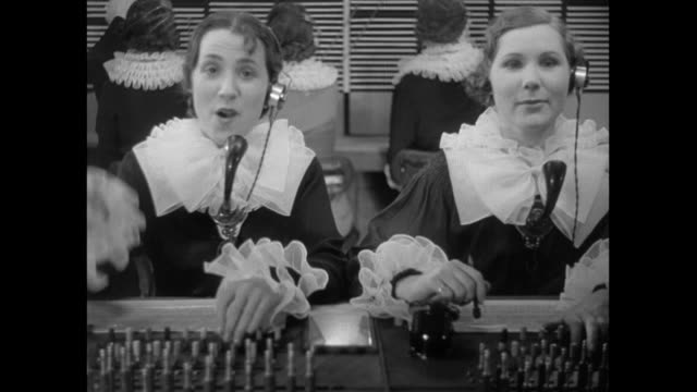 DS Telephone operators in matching costumes working and singing / United Kingdom