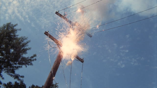 ms telephone pole with transformer burning and exploding with clouds  - transformer stock videos & royalty-free footage